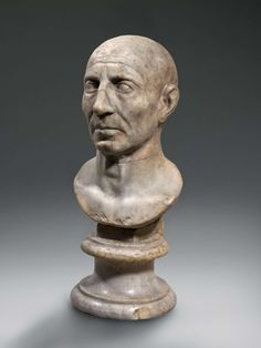 A republican portrait head of a man.  Marble. Height 53 cm. Rome, mid 1st century BC. Bust and plinth, 18th century.