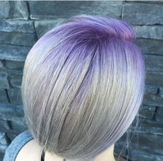 Bright purple root balayage melt into white blonde ends