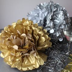 Pearl and Earl - Large Metallic Tissue Paper Pom Pom - Gold, £6.00 (http://www.pearlandearl.co.uk/large-metallic-tissue-paper-pom-pom-gold/)