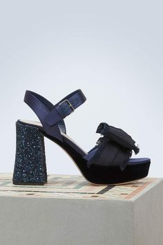 d4c0d8c0942 Slip on these platform sandals designed by Miu Miu and sport a very 70s  look of