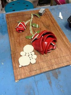 Clever way to make a Rose using pieces of cups.