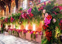 The creative direction for the floral installations involved a custom designed 12-metre truss structure positioned over the bridal table featuring cascading ferns, roses in oranges, pinks and reds and hydrangea accents.