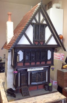 Unique one of a kind handbuilt Tudor dolls house complete with Bluetooth connectivity