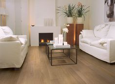 Quick-Step Hardwood Flooring - Compact 'Oak pure extra matt' (COM3100) in a modern living room. To find more living room inspiration, visit our website: https://www.quick-step.co.uk/en-gb/room-types/choose-the-perfect-living-room-flooring #salon #woonkamer