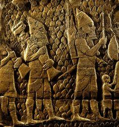 Soldados assírios carregando botim (detalhe da batalha de Lachis), Museu Britânico, Londres.