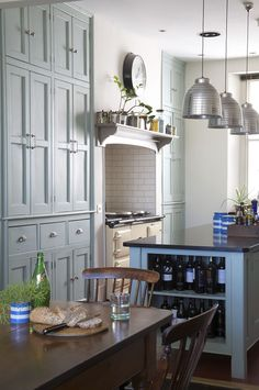 Penant lighting, turquoise cabinets, white tile