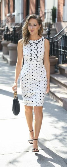 black and white polka dot sheath dress with scallop details and v-back, ankle strap black block heel suede sandals, black straw woven bag