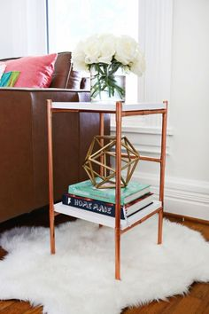 Copper décor trend is super hot now, many designers incorporate copper into their collections and home designs. Let's rock the trend and make this copper side table from abeautifulmess.com! The supplies are 20 feet of 1/2″ copper pipe, 1/2″ pipe strap (x4), 1/2″ copper caps (x8), 1/2″ copper tee fittings (x14), a pipe cutter, 12″...
