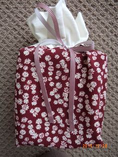 Cream/burgundy floral tissue box cover made by Sheila.