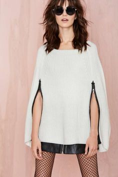 Talk to me about this cape sweater. Why isn't it in our closets yet? #fall #fashion