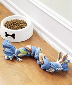 Whip up a dog toy in a few minutes using three old dish towels.