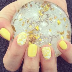 Yellow and paisley nails