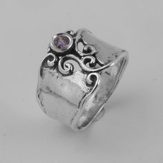 Sterling Silver HaMMered Band Ring Embellished With A 4MM Lavender CZ With Decorating Waves