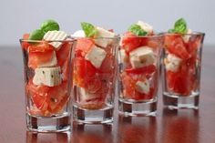 17. Savory treats... tomato, basil, mozzarella salad in a shot glass!  Love that summer wedding app.  #modcloth #wedding