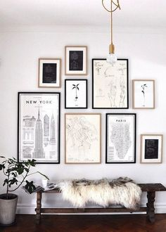 Travel-themed, black and white gallery wall (via Sacramento Street). #Entryway