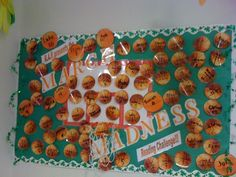 "This bulletin board is part of our reading incentive program in March called ""March Madness."" Students are encouraged to read 20 mins every day.  They fill-out weekly logs and for every 20 minutes they read, they get to shoot a basket in a Nerf basketball hoop (not pictured) and their name is written on a laminated basketball hung on this display. They also receive special basketball stickers as prizes."