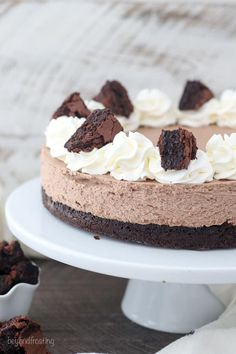 Take a big bite of this Brownie Bottom Brownie Batter Cheesecake! It starts with a layer of fudgy brownie on the bottom and it's topped with a mouthwatering no-bake brownie batter cheesecake, whipped cream and fudge. I'll take any excuse to make this loaded brownie cheesecake!