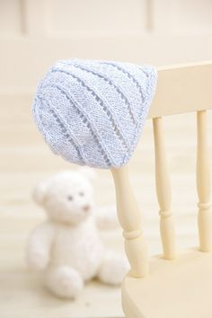 Pastel blue baby cap with stripes made with the Knook™. Buy this in a book bundle: http://www.leisurearts.com/sale/bundles/knook-baby-value-pa…