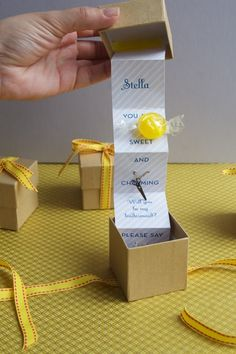 cleaver box invitation or card. This would be so cute to ask bridesmaids. Just put a ring pop in the box with it!