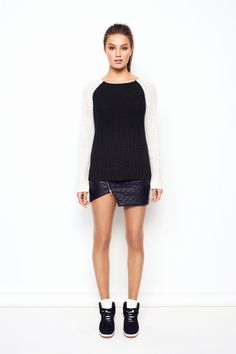 Chunky knitted sweater in black with white sleeves.Loose fit.