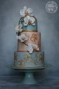 vintage pink and blue cake with gold orchid brush embroidery and white isomalt sugar orchids