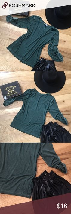 """Relaxification From the Karamel Collection Santa Barbara, CA. Very cool clothing and this simple top is so comfy. Lightweight 50% cotton 50% viscose that has a unique dye. The washed out affect brings a cool look to the rounded collar style tee. It has three quarter length sleeves that have gathers with a button which you may unbutton and wear longer. Very comfy and easy to dress up or dress down, whatever suits your fancy. Underarm across 18"""", shoulder to hem 22"""". May fit a Med-large see…"""