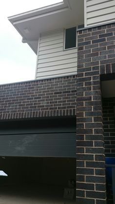 Surfmist gutter, fascia and weatherboard, blue flash steel bricks, basalt garage door and balustrade