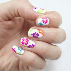 Summer may be coming to a close, but you can keep the beach party going well into the cooler months with this colorful tropical nail design. Follow our simple steps to re-create the look yourself! - DivineCaroline.com