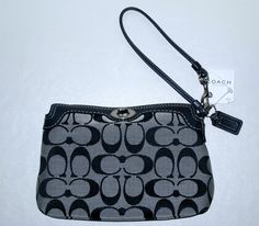 'COACH Classic Signature Turn Lock Large Wristlet ' is going up for auction at  2pm Sat, Aug 17 with a starting bid of $40.