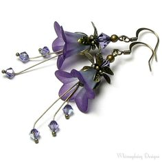 Whimsydaisydesigns has many great idea for jewelry. Unless you have the free time to do it yourself, good price too.  Wild Purple Floral Fantasy Crystal Earrings. 24.00, via Etsy.
