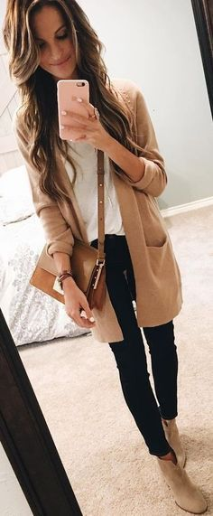 Take a look at 12 beautiful beige cardigan outfits to wear this fall in the photos below and get ideas for your own fall outfits!!! #thanksgiving #outfits Beige Cardigan // White Top // Black Skinny Jeans // Sandals Image source