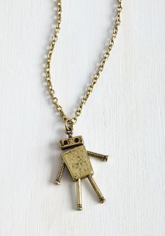 Lost in Bot Necklace. Get carried away dreaming of all the outfits thatll look complete with this antiqued gold necklace topping em off! #gold #modcloth
