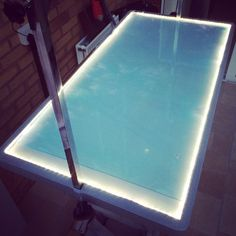 Pinned from gazettenet interior of custom grooming van diy grooming table with lights solutioingenieria Choice Image