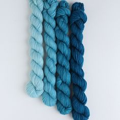 Sea Of Love gradient mini skein bundle offers four graduating colors from pale robin egg to a deep peacock blue. These bundles are great for ombre projects or the heals and toes in sock knitting. To learn more go to : http://threeirishgirls.com/