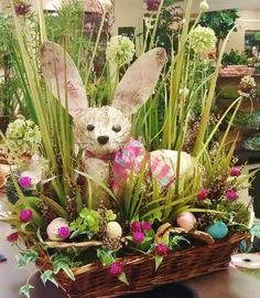 Love my cute bunny for Easter! I carved him  from styrofoam, covered him with thin layers of birch bark and then placed him in a low basket filled with grass, eggs and moss.