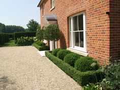 Garden and landscape designers based in Winchester, Hampshire, specialising in parkland and classical English manor style. Boxwood Landscaping, Front House Landscaping, Driveway Landscaping, Modern Landscaping, Landscaping Ideas, Front Porch Landscape, House Landscape, Garden Ideas Driveway, Manor Garden