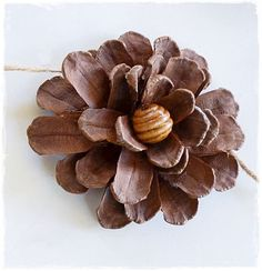Pine cone flowers love this is such a pretty diy i love that this simple garland is an easy one all you need are pine cones some f Handmade Flowers, Diy Flowers, Fabric Flowers, Paper Flowers, Flower Pots, Pine Cone Art, Pine Cone Crafts, Pine Cones, Crafts To Do