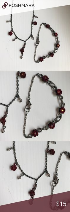 Deep red rose necklace and matching bracelet This matching set of necklace and bracelet are charming and vintage feeling with delicate rose accents. The rose is a deep red color and is accent with black hardware. Each rose has a sparkle within it. Delicate look compared to much of the bling looks out there Jewelry Necklaces