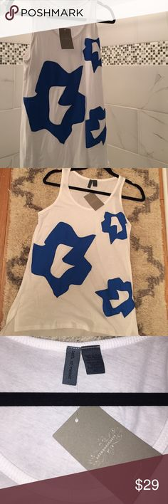 Anthropologie tank with patchwork designs NWT! Summer went by so quick in Michigan, I didn't have a chance to wear this beauty!     White hi-low tank with blue fabric (not a print, actual fabric designs stitched on!). Tag says XS, but it's more of Small. This is Anthropologie's brand Left of Center.    Original price $78, I purchased on sale for $39. Grab this deal!!! Anthropologie Tops Tank Tops