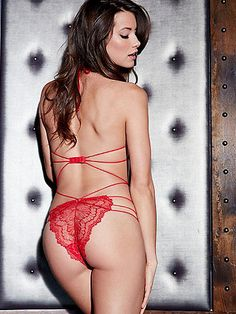 Strappy Lace Halter Teddy - A one piece that shows just the right amount of skin, this teddy mixes romance with seduction for unforgettable nights. Accentuating your curves with its body-baring design, it features:  <ul>    <li>Delicate eyelash lace</li>    <li>Ultra sexy straps</li>    <li>Cutout sides</li>    <li>Halter neck to lift and support</li>    <li>Full back with thin, strappy elastic detailing</li>    <li>Hook-n-eye closure</li>    <li>Nylon/spandex</li>    ...