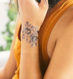Enthralling Wrist Blooms Tattoo