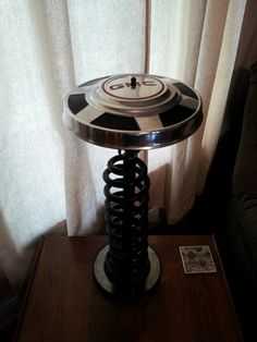 I saved all these items from the scrap yard. Used car parts from my husband's shop made a great lamp.