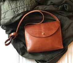 Cognac Ora Crossbody Bag, hand cut and stitched with rich brown leather with a minimal design. Created with oiled leather that will get better with age. Beautiful box shape and easy to carry bag. Amazing leather that will age well! Made to order please allow 2 weeks for shipment Length