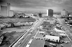 Larry Evans/© Houston Chronicle Aerial of Fannin, Main and Holcombe streets in 1964. Prudential Building on Holcombe is seen at left and Shamrock Hilton Hotel is at far right. Fannin Bank building is seen at the intersection of Main and Holcombe.