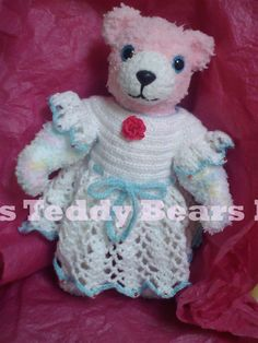 Little Sweetie Pie - Crocheted Teddy Bear with moveable arms and legs.  She is wearing a Crocheted dress that has red, glass beads in the sleeve points and hem points.  The dress has a crocheted waist tie and crocheted red rose.