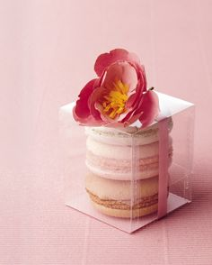 In Favor - A paper flower decorated a trio of pastel macarons to create a pretty and flavor-filled take-home treat for wedding guests. - From Dainty Delicacy to Wedding Must-Have: Tracing the Evolution of French Macarons