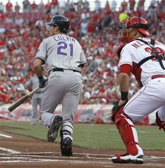 Colorado Rockies' Tyler Colvin (21) Heads To First On An Single Off Cincinnati Reds Starting Pitcher Mike Leake