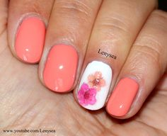 Spring/Summer Nails. Peach background with one cream nail with painted pink and peach flowers