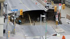 Workers look at a giant sinkhole in Ottawa, Canada, on June It led to the closure of the affected area and forced evacuation of businesses a few blocks from the National Parliament. Real Estate Prices, Scary Places, Shopping Center, Cool Photos, The Outsiders, Around The Worlds, The Incredibles, Ottawa Canada, June 8