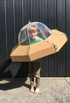 It's all about the details -- craft your own alien spaceship for kids and embark on a journey into outer space! Build a DIY cardboard spaceship with help from Zygote Brown Designs. Fete Halloween, Holidays Halloween, Halloween Crafts, Cardboard Costume, Diy Cardboard, Cardboard Mask, Cardboard Spaceship, Alien Spaceship, Space Costumes